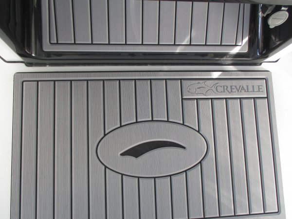 """Family friendly boats focused on reliability, durability, and excellence in design. Many of the design advantages of Crevalle Boats are listed below but are highlighted by our hatches that use 2nd generation position control hinges to eliminate lid supports that get in the way.  Our gunmetal grey helms knock down secondary glare and reduce eye fatigue.  Our livewells feature flow designs inspired by commercial saltwater aquarium designs that minimize dead water and maximize available dissolved oxygen.  Our electrical systems feature tinned copper wires that have their functions printed every 12"""" and use sealed connectors…even on buss bars!"""
